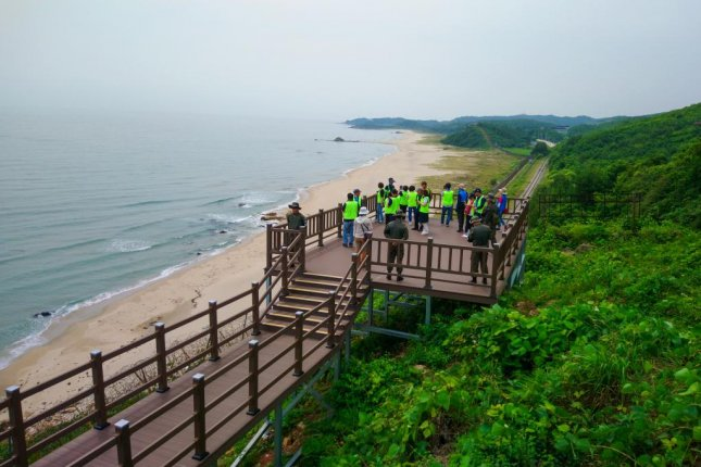 Tourists gather at the start of a trek along the recently opened DMZ Peace Trail in Goseong, South Korea. Photo by Thomas Maresca/UPI
