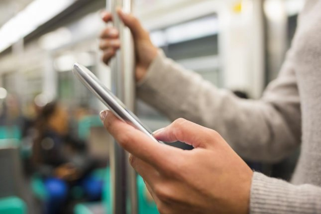 Dennis Nicholl, 63, was arrested in Chicago after using a cellphone jammer to block train passengers' signals on a local train, according to police. Photo by LDprod/Shutterstock