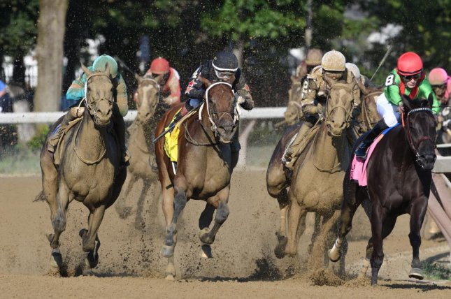 Eskimo Kisses (No. 2, white cap) starts her winning move in Saturday's Grade I Alabama at Saratoga. Photo courtesy of Arianna Spadoni/NYRA
