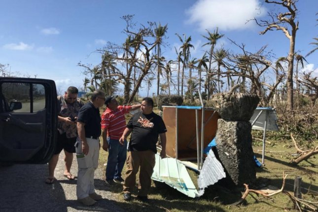 Super Typhoon Yutu downed power poles and damaged buildings and cars throughout the Northern Mariana Islands. Photo courtesy of FEMA