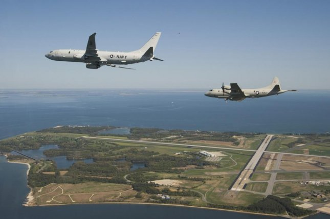 A P-8A maritime patrol aircraft (foreground) flying over Maryland. U.S. Navy photo by Liz Goettee