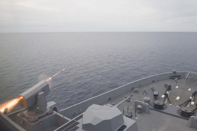 The San Antonio-class amphibious transport dock USS Anchorage fires a surface-to-air RIM-116 Rolling Airframe Missile as part of Essex Amphibious Ready Group Surface Warfare Advanced Tactical Training. Photo by Mass Communication Specialist 3rd Class Ryan M. Breeden/U.S. Navy