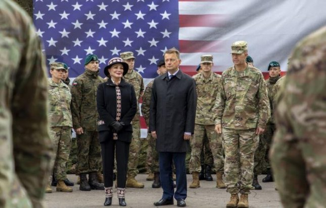 U.S. Ambassador to Poland Georgette Mosbacher, L, and Polish Defense Minister Mariusz Blaszczak, R, open the U.S. Army's 1st Infantry Division headquarters in Poznan, Poland, on October 4, 2019. Photo by Pvt. Joanna Goana Garcia/U.S. Army