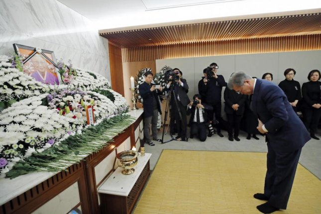 South Korean President Moon Jae-in bows in front of the altar of former comfort woman and activist Kim Bok-dong during a funeral ceremony at Severance Hospital in Seoul on Tuesday. Photo by Yonhap/EPA-EFE