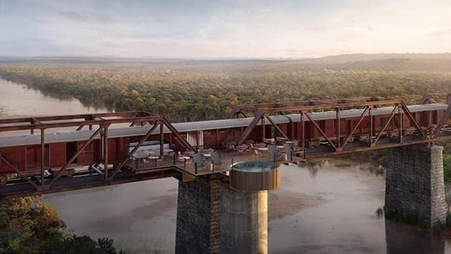 A luxury hotel preparing to open in South Africa's Kruger National Park consists of train cars converted into rooms and permanently parked on a historic bridge. Photo byKruger Shalati/Facebook