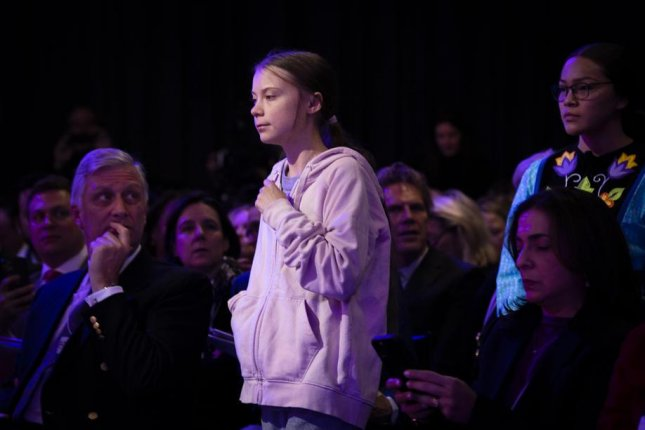 Swedish climate activist Greta Thunberg speaks Tuesday at a panel session during the World Economic Forum in Davos, Switzerland, Photo by Gian Ehrenzeller/EPA-EFE