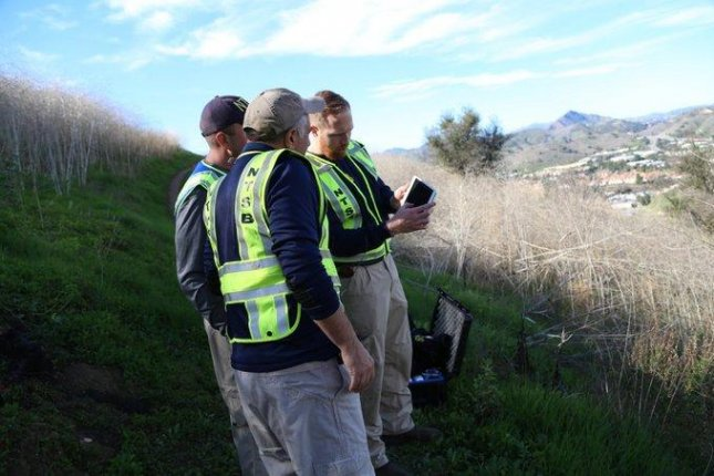 Investigators with the National Transportation Safety Board use equipment to map the area in Calabasas, Calif., on Monday where a helicopter crash killed basketball star Kobe Bryant, his daughter and seven other people. Photo courtesy of NTSB/Twitter