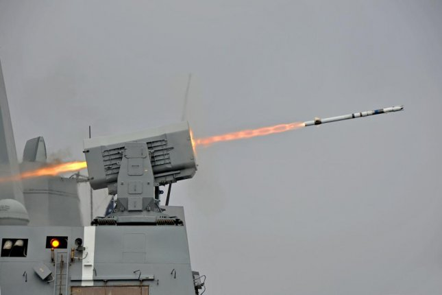 The U.S. Navy amphibious transport dock ship USS New Orleans fires a RIM-116 surface to air intercept missile from its Rolling Airframe Missile launcher in May 2013. Photo byGary Granger/U.S. Navy
