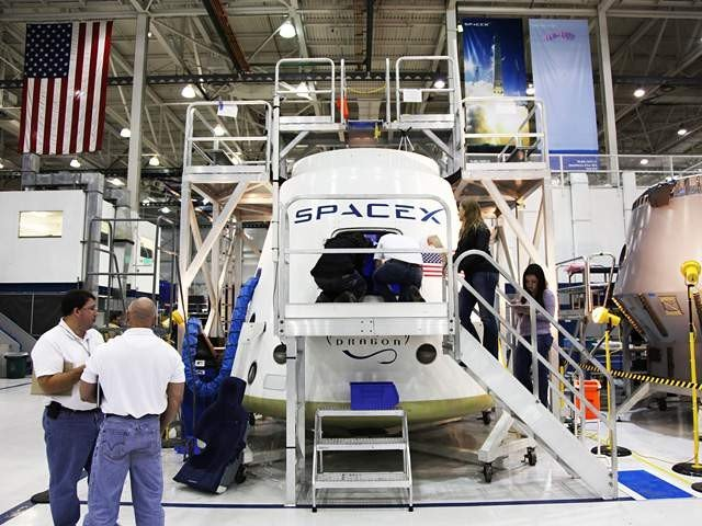SpaceX and NASA officials review the Dragon crew vehicle layout. An independent panel of former NASA astronauts and officials will help oversee SpaceX's efforts to develop systems safe for human spaceflight, the company announced. Credit: SpaceX