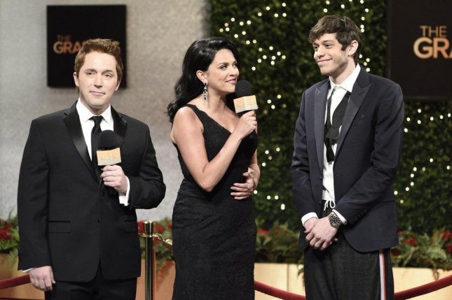 Beck Bennett, Cecily Strong and Pete Davidson appear in a Saturday Night Live sketch called The Grabbie Awards Photo by Will Heath/NBC