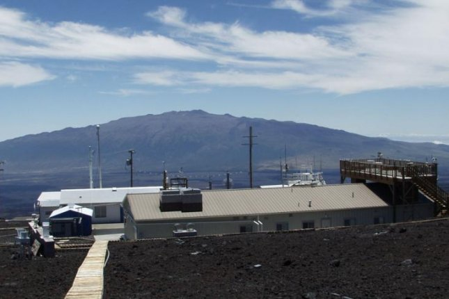 Scientists regularly measure the concentration of CO2 in atmospheric samples collected at NOAA's Mauna Loa Observatory. Photo by NOAA