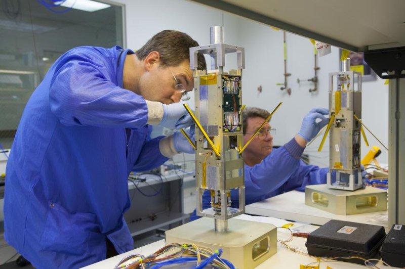 Technicians work on components of a nano satellite for the U.S. Navy. Photo courtesy John Hopkins University Applied Physics Laboratory