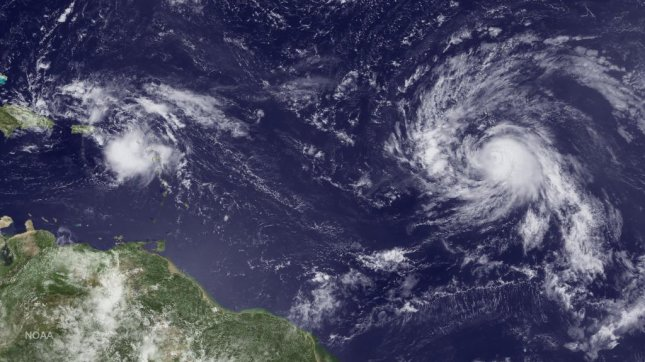 Tropical Storm Gaston, right, looks more impressive than Invest 99L (on the left) in this GOES East satellite image. But looks can be deceiving. Gaston may strengthen into a hurricane but it's heading to open water with no threat to land. 99L is expected to strengthen into Tropical Storm Hermine, possibly reaching hurricane strength before approaching South Florida late Sunday and early Monday. Photo courtesy NOAA