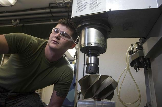 U.S. Marine Lance Cpl. Charles Matte, a machinist with 1st Maintenance Battalion, mills an impeller fan on a computer numerically controlled lathe machine in Camp Pendleton, Calif., on Oct. 17, 2017. In January 2019, Marine Corps Systems Command reviewed the results of 3D-printed impellers at Twentynine Palms, Calif. Photo by Cpl. Joseph Sorci/U.S. Marine Corps