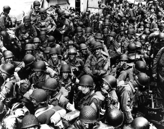 Army troops on board a LCT, ready to ride across the English Channel to France to take part in the Allied invasion of German-occupied France. Some of these men wear 101st Airborne Division insignia. Photograph released June 12, 1944. Photo by U.S. Navy/National Archives/UPI