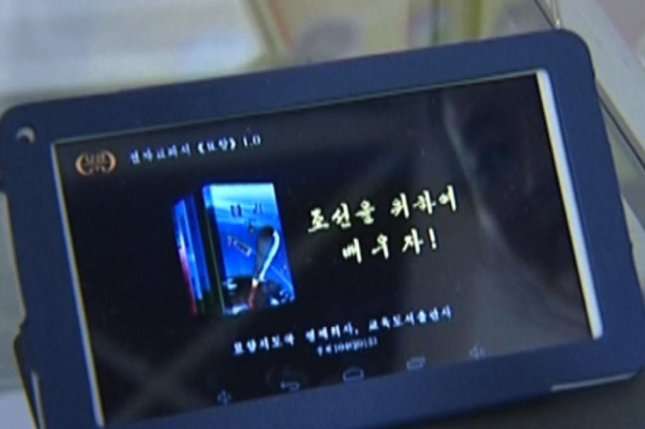 """The technology that was featured in North Korea's propaganda coverage included the next-generation """"Myohyang"""" tablet, and a North Korean salesman was quoted as saying that it is """"stylish and simple to use, and watching TV is possible"""" on the screen. Photo by KCNA/Yonhap"""