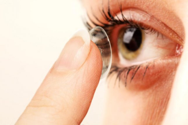 Researchers at Harvard designed a contact lens that slowly delivers medication to the eye, allowing for an easier method of treating glaucoma than the standard eye drops. Photo by abd/Shutterstock