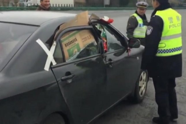 Watch: Chinese police pull over badly damaged car with cardboard