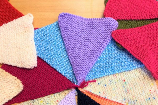 Knitters in Britain are working from home to break the Guinness World Record for the longest knitted bunting. Photo courtesy of the Devon County Show