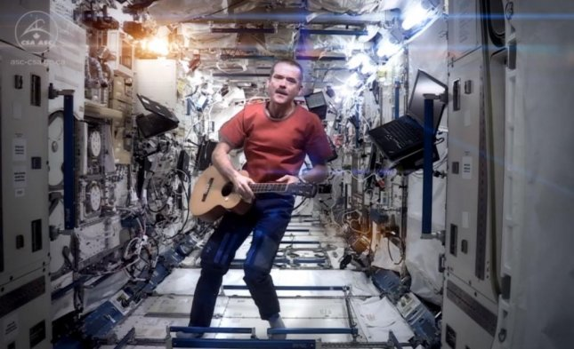 Canadian Astronaut Chris Hadfield played guitar and sang David Bowie's Space Oddity in a video he recorded aboard the International Space Station. (YouTube screenshot via Chris Hadfield)