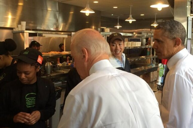 Vice President Joe Biden and President Barack Obama order lunch at a Shake Shack in Washington, D.C., where they met with construction workers as part of a push to urge Congress to pass transportation funding. (Twitter/@whatsyrgamenow)