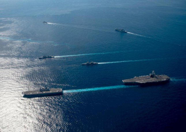U.S. Navy vessels assigned to Ronald Reagan Carrier Strike Group join ships from Japan Maritime Self-Defense Force Escort Flotilla 1, Escort Flotilla 4 and the Royal Canadian Navy in formation during the Keen Sword 21 exercise. Photo by Mass Communication Specialist Seaman Askia Collins/U.S. Navy