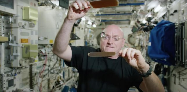 Astronaut Scott Kelly demonstrated a pair of super-hydrophobic polycarbonate paddles by bouncing a large drop of water between them like a ping pong ball. Photo by Scott Kelly/Facebook