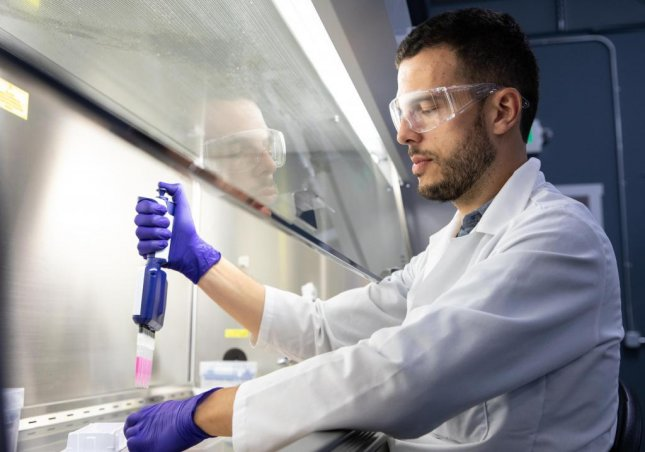A scientist works in a lab at the company Just, which is producing a lab-grown chicken nugget product it plans to make commercially available this year. Photo courtesy of Just