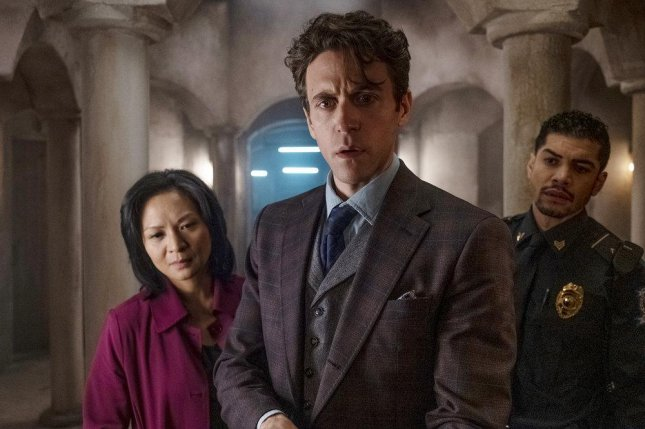 Robert Langdon (Ashley Zukerman, center) leads Agent Sato (Sumalee Montano) and security guard Nunez (Rick Gonzalez) to decipher clues in The Lost Symbol. Photo courtesy of Peacock