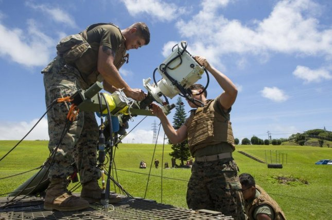 U.S. Marines test the Free Space Optics laser communications system earlier this month at Camp Hansen in Okinawa, Japan. Photo by Sgt. Timothy Valero/U.S. Marine Corps