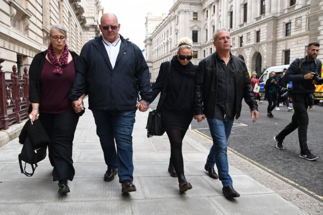 The family of Harry Dunn departs the Foreign Office on October 9, 2019, after a meeting with British Foreign Secretary Dominic Raab to discuss a vehicular death case against the wife of a U.S. diplomat. File Photo by Andy Rain/EPA-EFE
