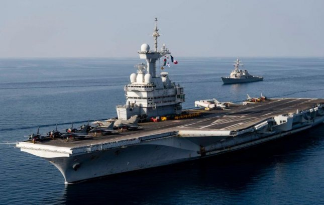 The USS Donald Cook joined the carrier strike group of the French Navy aircraft carrier Charles de Gaulle, pictured, during NATO's Dynamic Manta drills this week off the Italian coast. Photo courtesy of U.S. Navy