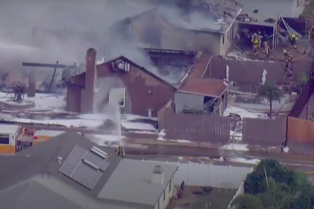 Two people, including a UPS driver, were killed when a small plane crashed in a neighborhood in San Diego on Monday. Screen Capture/CBS8/YouTube