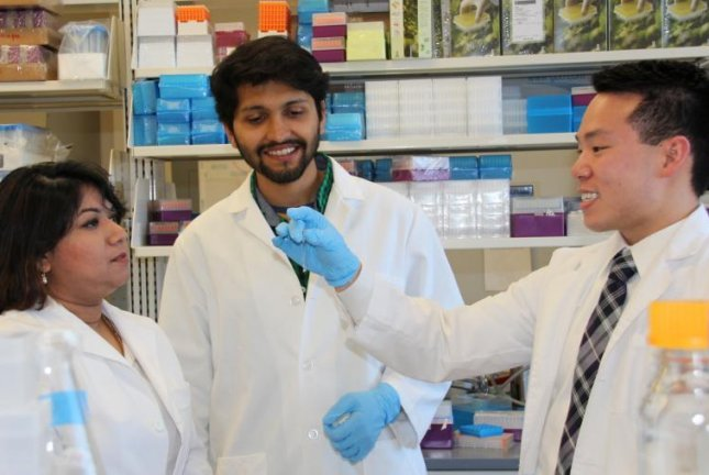 Dr. Mahua Choudhury, left, an assistant professor at the Texas A&M Rangel College of Pharmacy, works with professional student pharmacist Jason Chau and research assistant Yudisthar Singh Bedi while designed the hydrogel condom that could help limit the spread of HIV. Photo by Texas A&M University