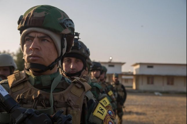 Iraqi forces soldiers wait to begin training at Camp Taji, Iraq, on Sunday. The soldiers were learning from coalition personnel how to search personnel and vehicles for improvised explosive devices. On Tuesday, Iraq officially declared east Mosul has been fully liberated from the Islamic State. Photo courtesy of Spc. Christopher Brecht /U.S. Army