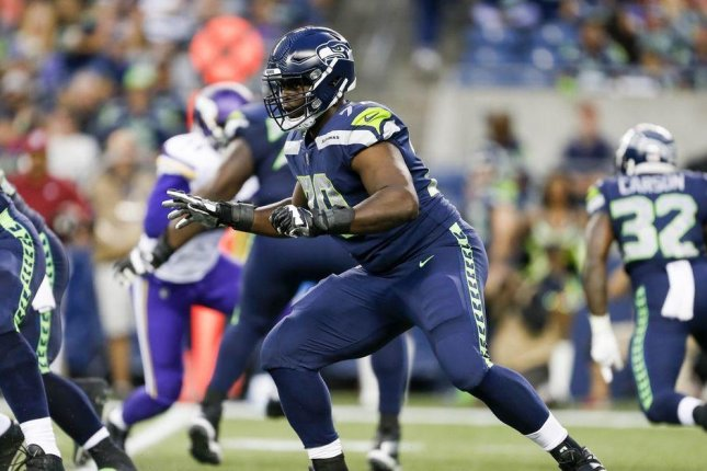 Seattle Seahawks left tackle Rees Odhiambo (pictured) was taken to a hospital Sunday night after he experienced trouble breathing. Photo courtesy of Seattle Seahawks/Twitter