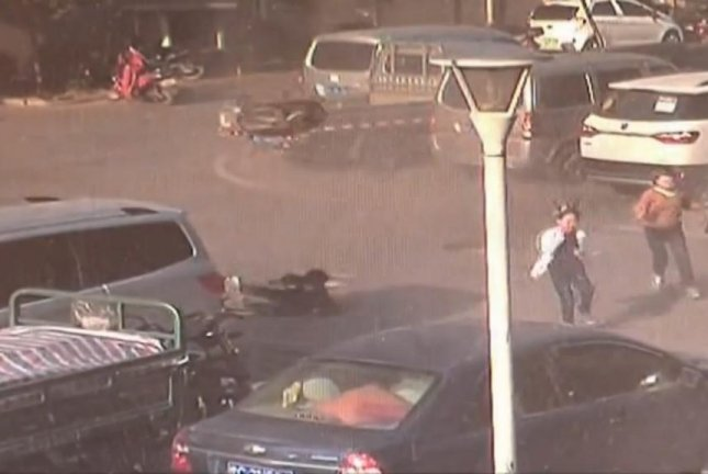 Manhole covers are blasted into the air after a boy dropped a lit match into the sewer. Screenshot: Newsflare
