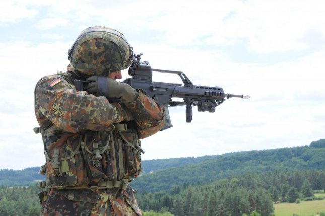 A German army soldier looks through the scope of his G36 assault rifle at an improvised explosive device during a training exercise at the Joint Multinational Readiness Center in Hohenfels, Germany, June 27, 2012. U.S. Army photo by Spc. Fredrick Willis