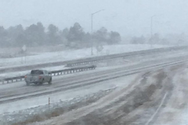 A storm blanketed Colorado, Wyoming, Minnesota and South Dakota with snow on Wednesday, resulting in closed freeways and schools and grounded some U.S. flights. Photo courtesy of the Colorado Department of Transportation