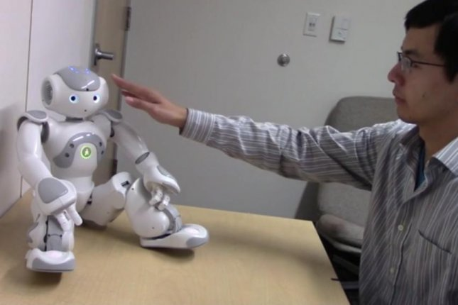 Study participants experience heightened physiological arousal when touching more intimate parts of a robot's body. Photo by Stanford University