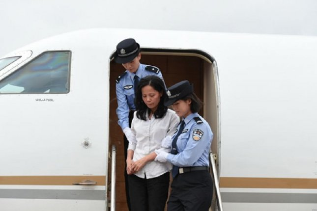 Chinese fugitive Kuang Wang Fang arrived in China on a chartered jet Thursday. Kuang was convicted of laundering $485 million from a state-owned Chinese bank and was deported from the United States. Photo courtesy of People's Republic of China Central Commission for Discipline Inspection