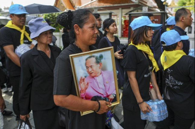 Mourners wait in line as they make their way to the Royal Crematorium in Bangkok, Thailand, on Wednesday. Photo by Diego Azubel/EPA