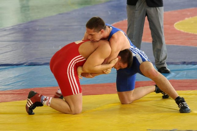 A new study from researchers at the University of Colorado have found high school wrestelers experience a majority of reported sports-related skin infections. Photo by Istvan Csak/Shutterstock
