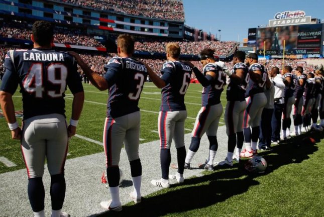 The New England Patriots, who indicated during the week they wouldn't do anything after 16 players took a knee last Sunday in reaction to comments made by President Donald Trump, stood in a line, right hands on their hearts, left hands on a teammate's shoulder. Photo courtesy of Boston 25 News/Twitter