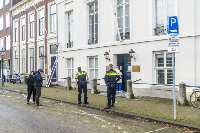 Dutch police investigate a shooting outside the Saudi Embassy in The Hague, Netherlands, on Thursday. Photo by Lex Van Lieshout/EPA-EFE