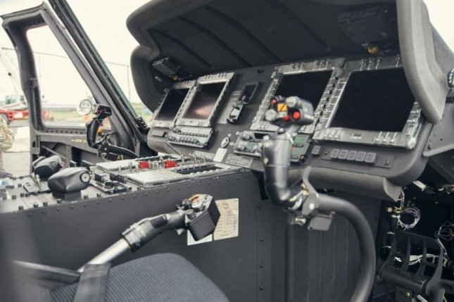 The U.S. Army extended its pilots' service obligation to 10 years this week. It applies to pilots of fixed-wing aircraft and helicopters. The cockpit of a UH-60M Black Hawk helicopter of the New York National Guard is depicted. Photo by TSgt. Ryan Campbell/U.S. Army