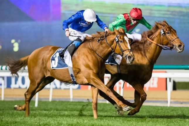 Magic Lily (No. 3) edges Nisreen in Thursday's Group 2 Cape Verdi at Meydan in Dubai, breaking the course record for 1 mile on the grass. Photo by Erika Rasmussen, courtesy Dubai Racing Club