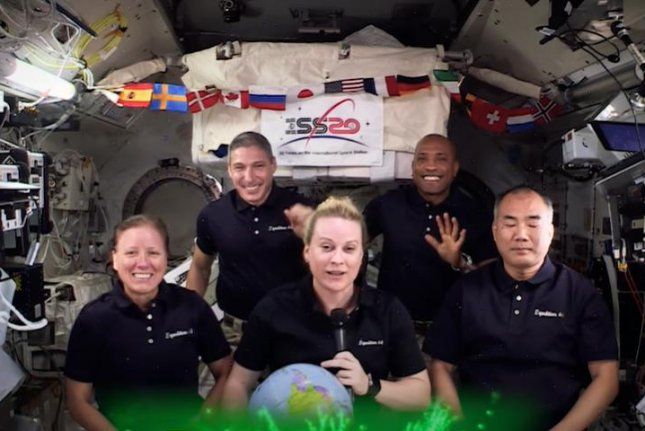 The Expedition 64 crew on the International Space Station offer those on Earth a Happy New Year. Photo courtesy of NASA