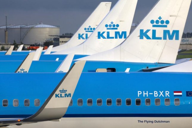 A Scottish man was arrested fined $675 and given a five-year ban from KLM Airlines after he allegedly attempted to open the plane door in flight. & Man arrested for trying to open plane door at 30000 feet - UPI.com Pezcame.Com