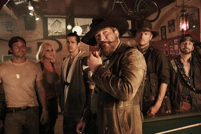The cast of Dead 7. Pictured: (l-r) Jeff Timmons as Billy, Carrie Keagan as Daisy Jane, Erik-Michael Estrada as Komodo, Joey Fatone as Whiskey Joe, Nick Carter as Jack and Howie Dorough as The Vaquero Photo by The Asylum/Syfy